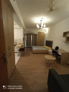 Gallery Cover Image of 507 Sq.ft 1 RK Apartment for rent in Nimbus The Golden Palms, Sector 168 for 14000