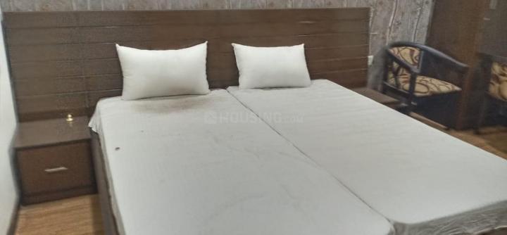 सेक्टर 27 में गर्ल्स/बॉइज़ पीजी नोएडा के बेडरूम की तस्वीर