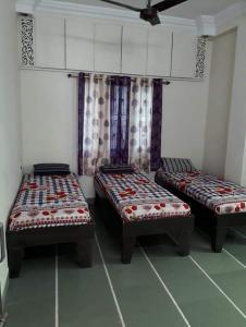Bedroom Image of Gopal Krishna PG in Satellite