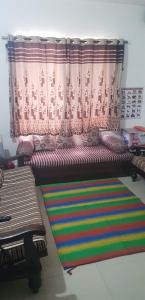 Gallery Cover Image of 556 Sq.ft 1 BHK Villa for buy in SP Trimurti Villa, Dhayari for 2650000