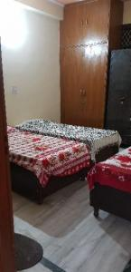 Bedroom Image of Jitender Girls PG in Palam
