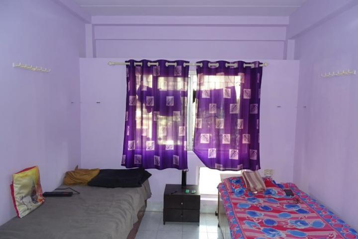 गोरेगांव ईस्ट में अदित्य पीजी के बेडरूम की तस्वीर