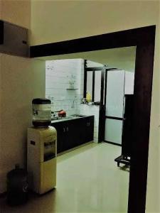 Kitchen Image of Khushi PG in Naranpura