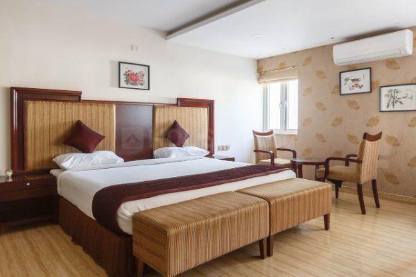 डोमलूर लेआउट में स्टुडियो रूम इन अपोलो ग्रीन्स के बेडरूम की तस्वीर