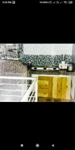 Kitchen Image of Royal Palace PG Hostel in Andheri West