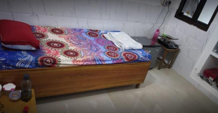 वसुंधरा में राघव पीजी में बेडरूम की तस्वीर