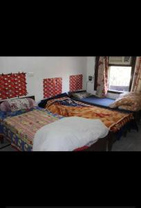 Bedroom Image of Maa Durga Boys PG in Sector 27