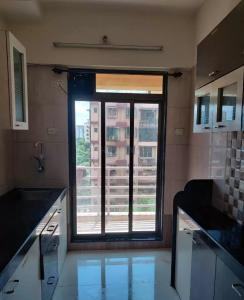 Gallery Cover Image of 740 Sq.ft 1 BHK Apartment for rent in Abhay Sheetal Complex Wing D E, Mira Road East for 14500