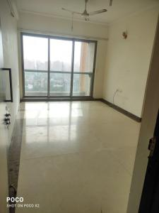 Gallery Cover Image of 1265 Sq.ft 3 BHK Apartment for rent in Kalpataru Towers, Kandivali East for 45000