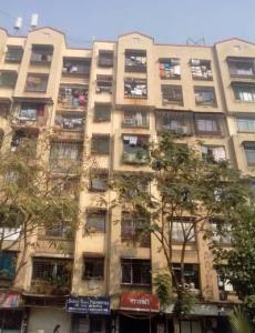 Gallery Cover Image of 750 Sq.ft 1 BHK Apartment for buy in Sainath Apartment, Malad West for 9000000