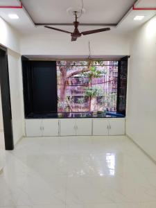 Gallery Cover Image of 350 Sq.ft 1 RK Apartment for rent in Saraf Chaudhary Nagar CHS, Kandivali East for 15000