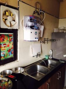 Kitchen Image of Girls PG in Sushant Lok I