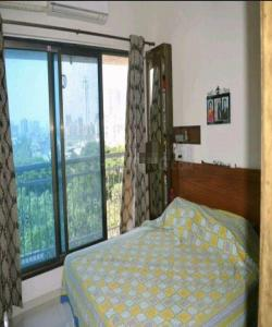 Gallery Cover Image of 1200 Sq.ft 2 BHK Apartment for buy in Jogeshwari West for 22500000