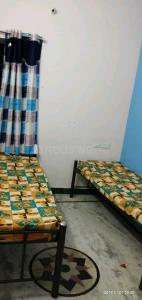 Bedroom Image of Sri Kalaivani PG in Sholinganallur