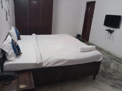 सेक्टर 22 में देव पीजी के बेडरूम की तस्वीर