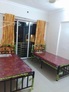 पवई में पीजी इन भांडूप के बेडरूम की तस्वीर