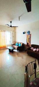 Gallery Cover Image of 1200 Sq.ft 2 BHK Apartment for rent in Siddhachal CHS, Thane West for 30000