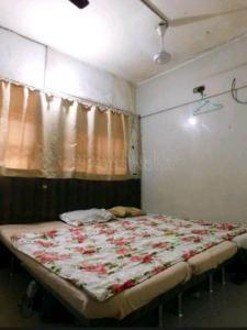 Bedroom Image of Hari PG Rooms in Kandivali West