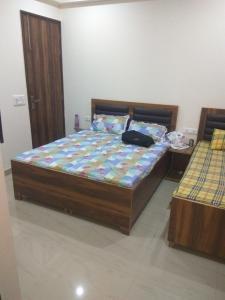 सोहना रोड, सुभाष चौक , राजीव चौक गुड़गांव इन सेक्टर 47 में बॉइज के लिए बेडरूम इमेज ऑफ पीजी