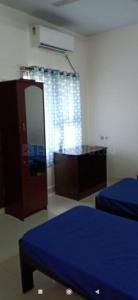 नवालूर में ज़ोलो एआरके के बेडरूम की तस्वीर