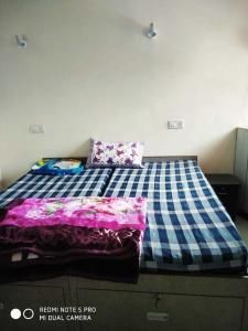 Bedroom Image of Arpit PG in Begumpur
