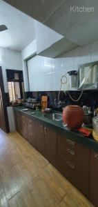Kitchen Image of 750 Sq.ft 2 BHK Apartment for buy in Jatayu Buildings, Mira Road East for 8500000