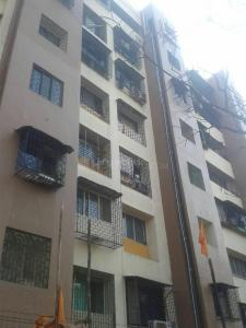 Gallery Cover Image of 900 Sq.ft 2 BHK Apartment for buy in Surya Group Gokul Garden, Kandivali East for 12500000