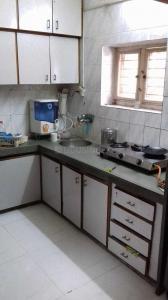 Kitchen Image of Pooja PG in Satellite