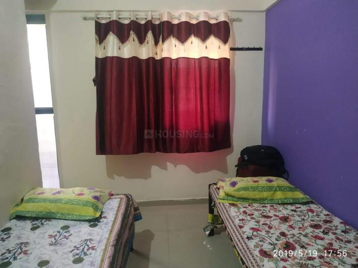 घनसोली में शिवम पेइंग गेस्ट के बेडरूम की तस्वीर