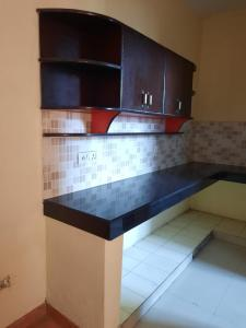 Kitchen Image of Aadi Residence in Sector 17