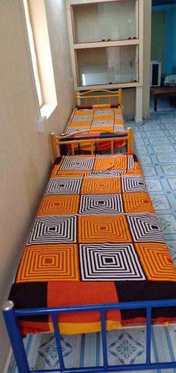 नवालूर में चेन्नै एसआर मेंस होस्टल के बेडरूम की तस्वीर
