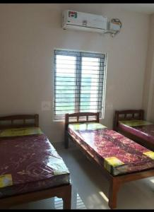 Bedroom Image of Sri Vainkateshwara Sai Mens Hostel in Karapakkam