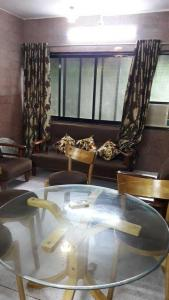 Gallery Cover Image of 610 Sq.ft 1 BHK Apartment for rent in Ganpati Villa, Thane West for 21000