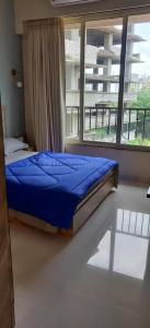 Gallery Cover Image of 1050 Sq.ft 2 BHK Apartment for buy in Shree Shakun Heights, Goregaon East for 18400000