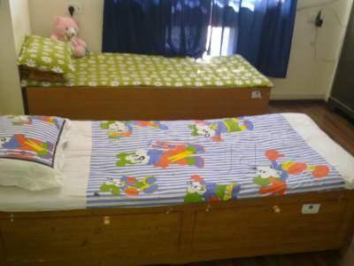 मलाड ईस्ट में स्नैकर्स अकॉमोडेशन पीजी में बेडरूम की तस्वीर