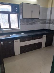 Gallery Cover Image of 600 Sq.ft 1 BHK Apartment for rent in Reputed Saraf Chaudhary Nagar CHS, Kandivali East for 23000