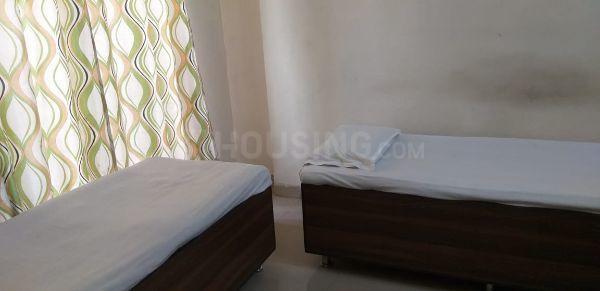आस्था हॉस्पिटैलिटी सेरविसेस इन बोरीवली ईस्ट के बेडरूम की तस्वीर