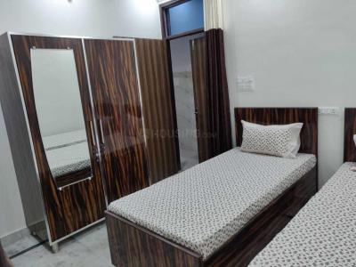 Bedroom Image of Dharam Niwas PG in Mansa Ram Park