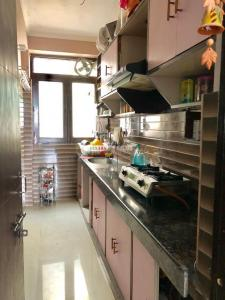 Gallery Cover Image of 1200 Sq.ft 2 BHK Apartment for buy in Chhattarpur for 4200000