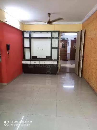 नीलसिद्धि जय बालाजी सीएचएस, नेरुल  में 16000000  खरीदें  के लिए 16000000 Sq.ft 2 BHK अपार्टमेंट के लिविंग रूम  की तस्वीर