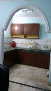 Kitchen Image of Boys And Girls PG in Chhattarpur