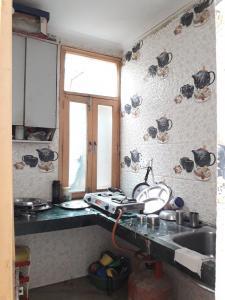 Kitchen Image of Sri Ram Niwas PG in Patel Nagar