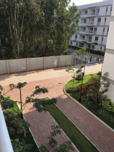 Gallery Cover Image of 1142 Sq.ft 2 BHK Apartment for rent in Electronic City for 21000