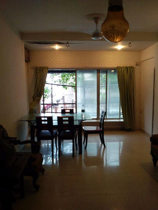 Living Room Image of 750 Sq.ft 1 BHK Apartment for rent in Andheri West for 45000