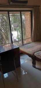 Gallery Cover Image of 800 Sq.ft 2 BHK Apartment for rent in Palms Apartment 2, Goregaon East for 28000