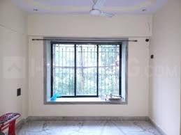 Gallery Cover Image of 510 Sq.ft 1 BHK Apartment for buy in Surya Group Gokul Garden, Kandivali East for 8000000