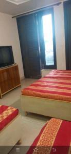 Bedroom Image of Nisha PG in Paschim Vihar