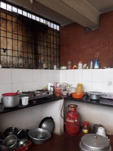 Kitchen Image of Venkata Sai PG in Marathahalli