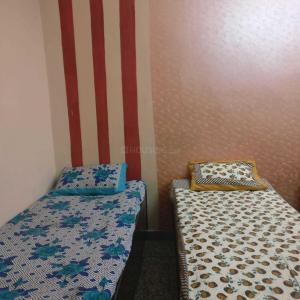 Bedroom Image of Sunita PG in Sector 3 Rohini