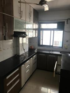 Gallery Cover Image of 900 Sq.ft 2 BHK Apartment for rent in Krishna Galaxy, Santacruz East for 45000